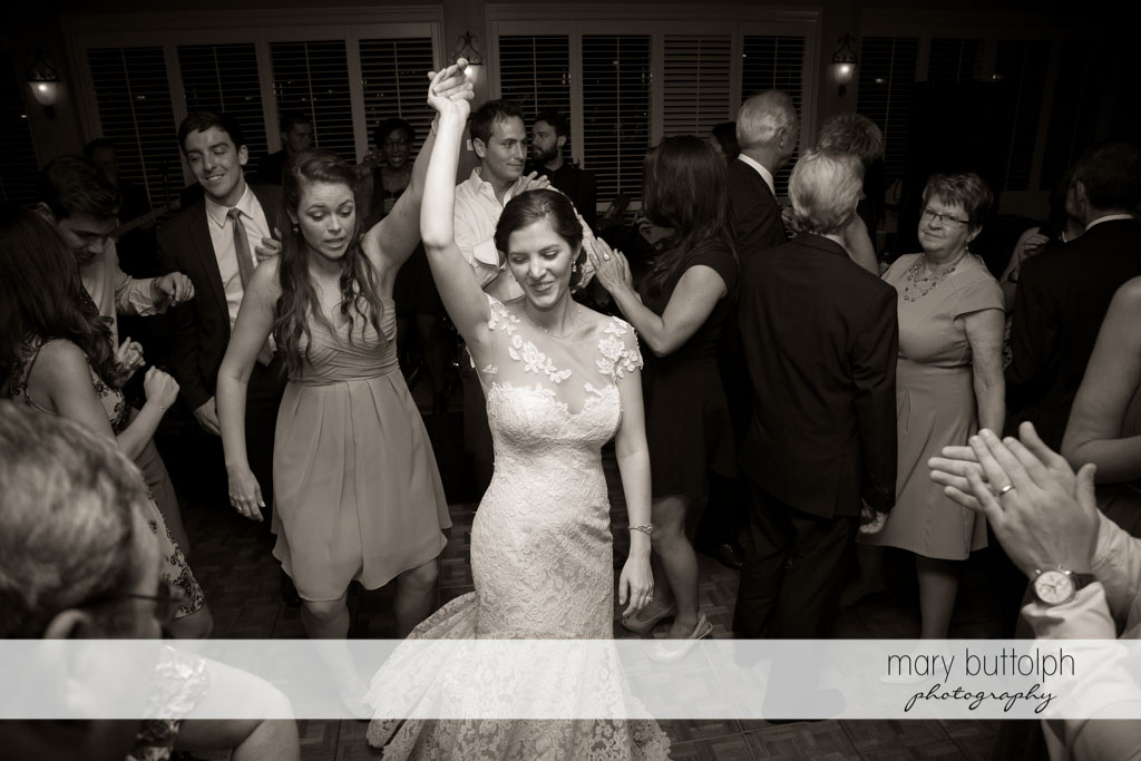Bride shows her moves on the dance floor at Skaneateles Country Club Wedding