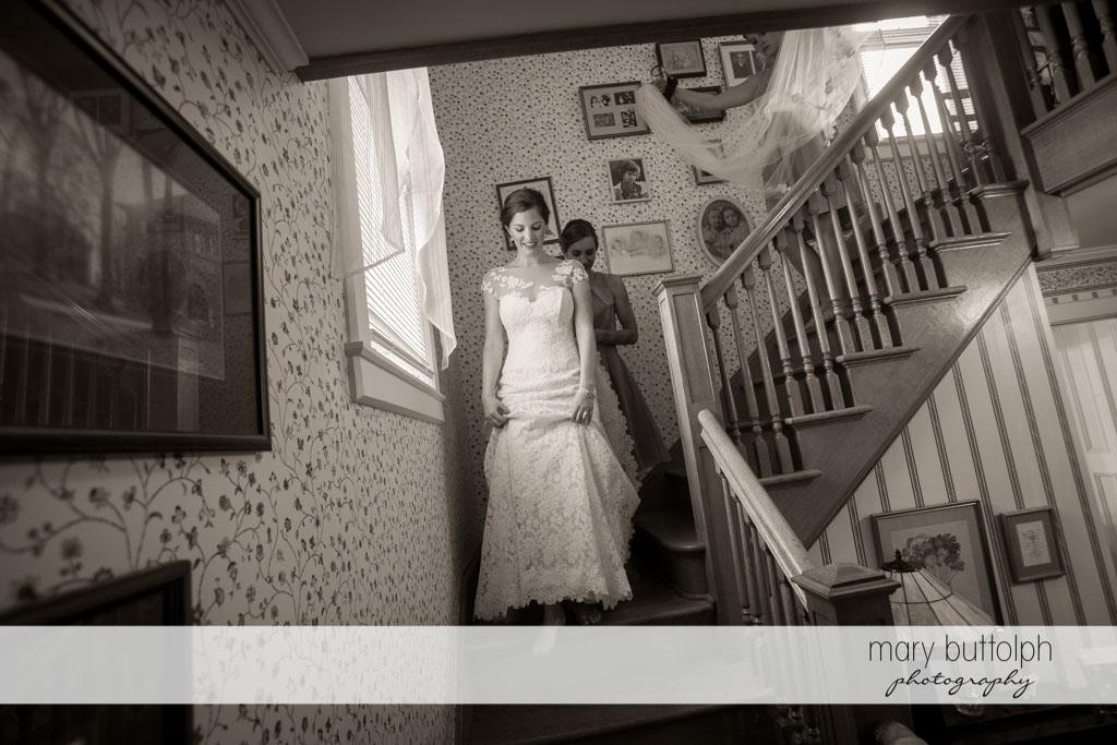 Bride goes downstairs to meet the groom at Skaneateles Country Club Wedding