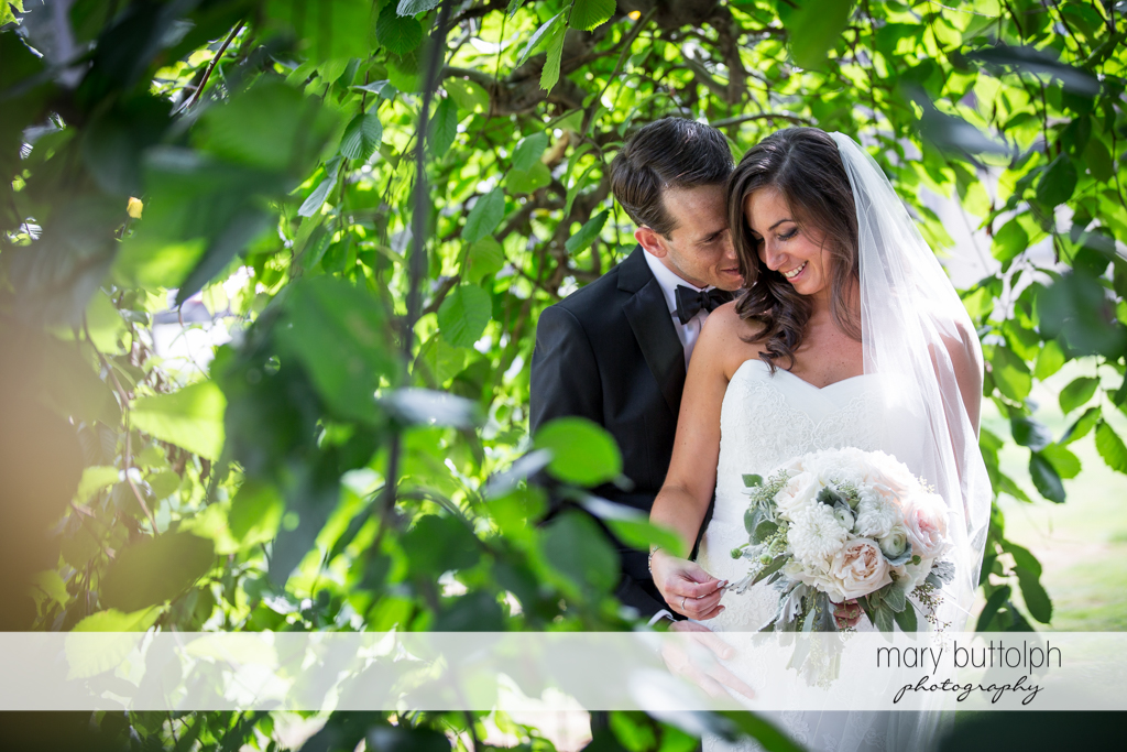 Couple share a romantic moment in the garden at the Brewster Inn Wedding