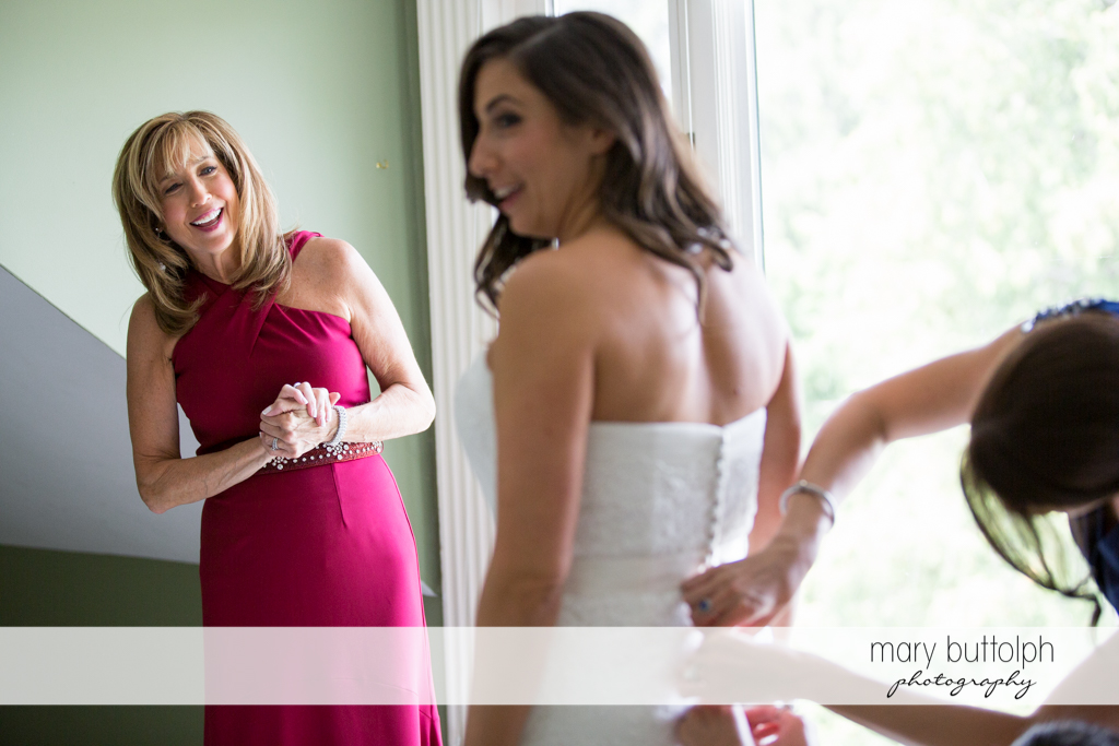Bride and her mom chat while the former's dress is fixed at the Brewster Inn Wedding