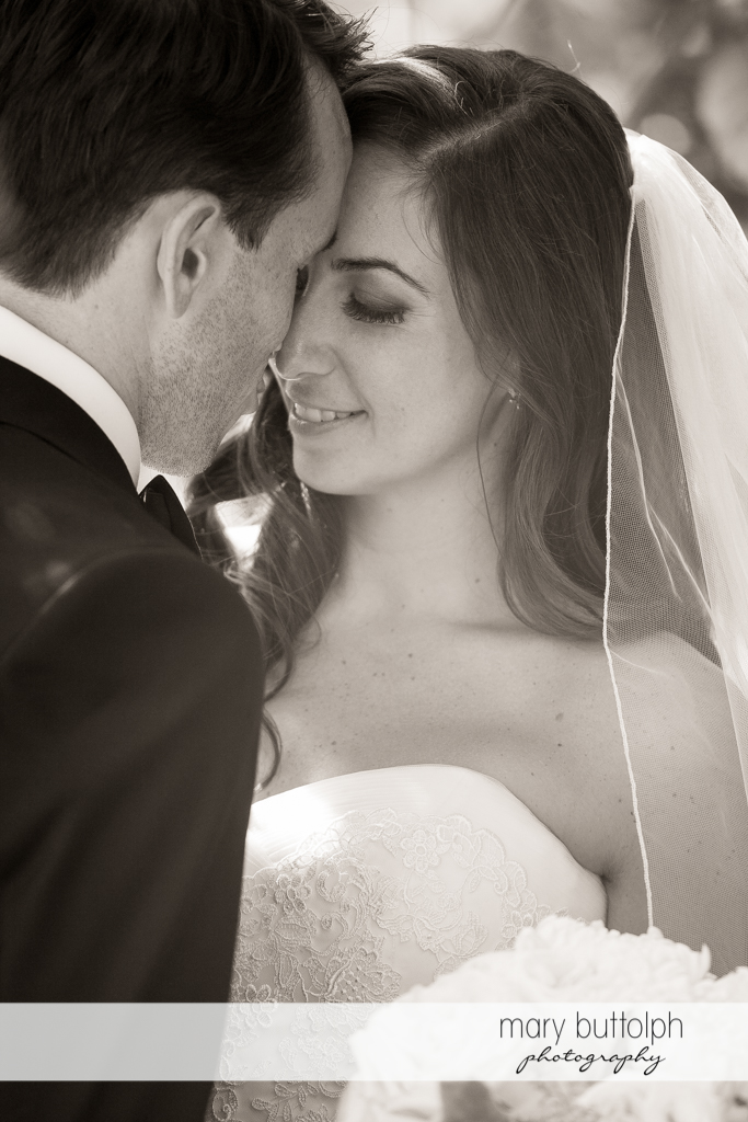 Couple rub noses in this dramatic black and white shot at the Brewster Inn Wedding