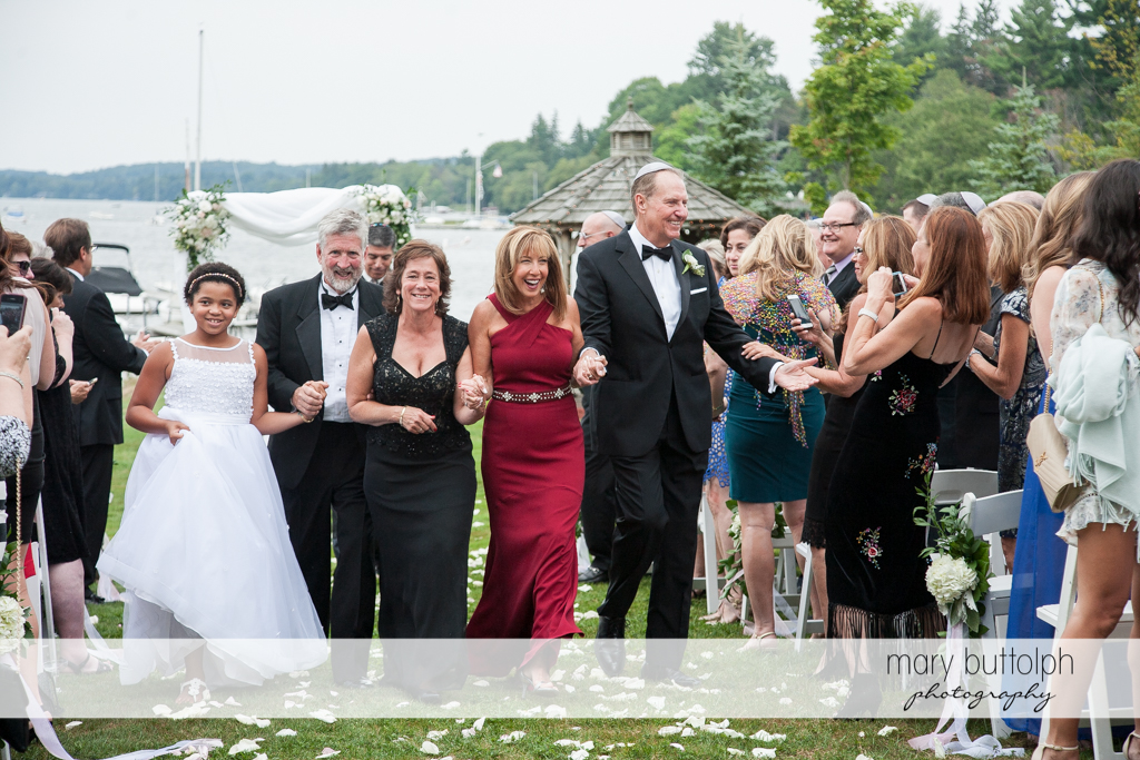 Bride's parents and guests celebrate after the wedding at the Brewster Inn Wedding