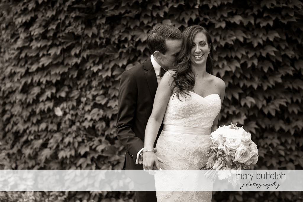 Couple get romantic in the garden at the Brewster Inn Wedding