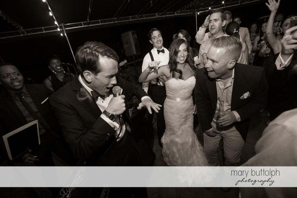 Groom shows his rapping skills to guests on the dance floor at the Brewster Inn Wedding