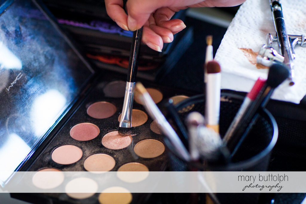 Bride's powder foundation and makeup brushes at the Brewster Inn Wedding