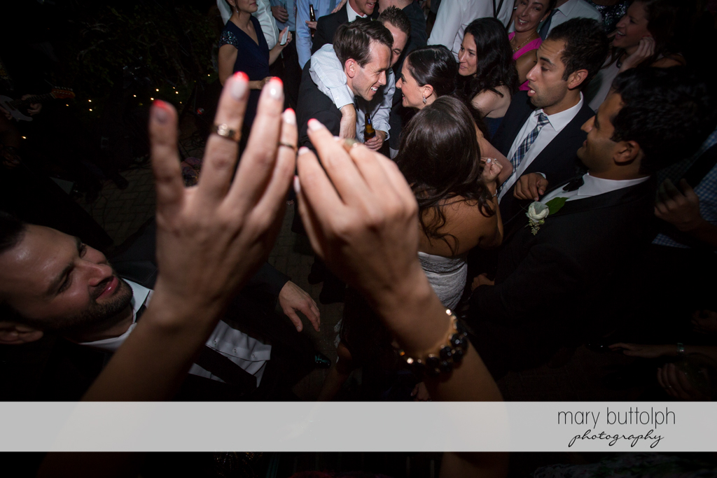 Couple having a great time with guests at the Brewster Inn Wedding