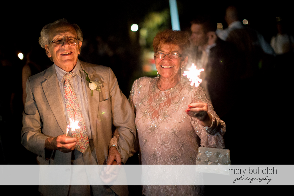 Guests light up the night with sparklers at the Brewster Inn Wedding