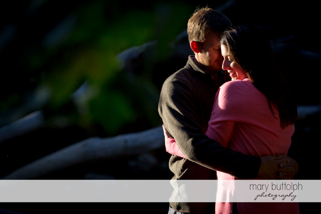 Couple share warm embrace in the park at Marcellus Engagement