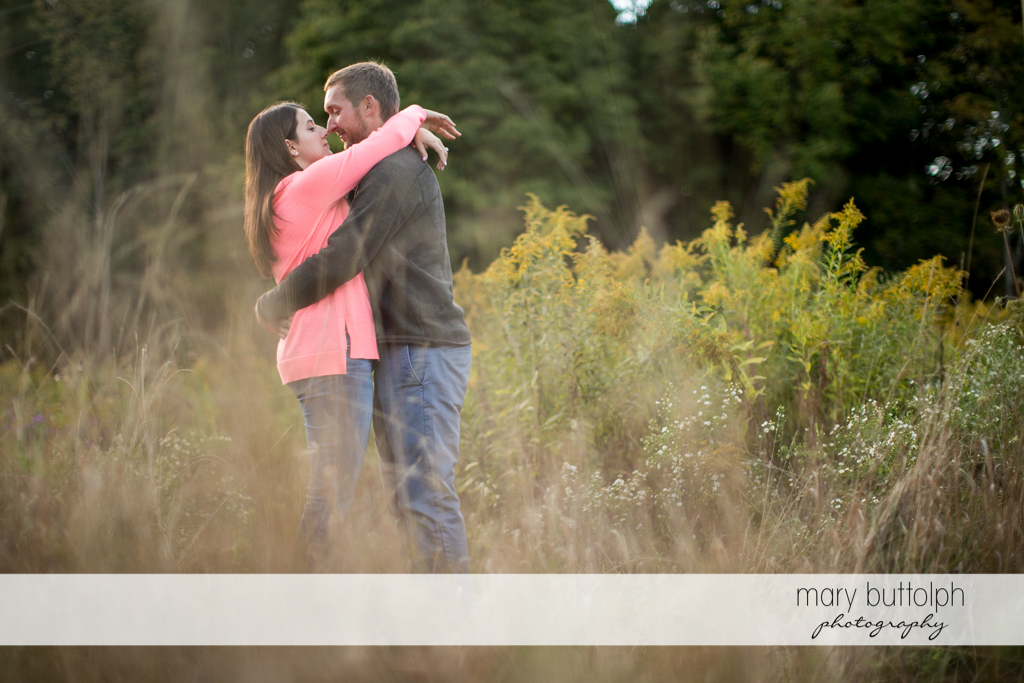 Couple embrace in the park at Marcellus Engagement