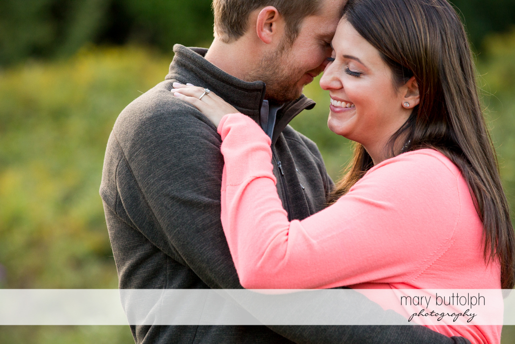 Couple in a romantic mood in the park at Marcellus Engagement
