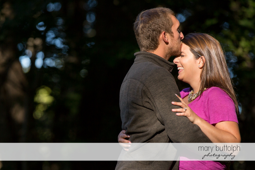 Couple in loving embrace at Marcellus Engagement