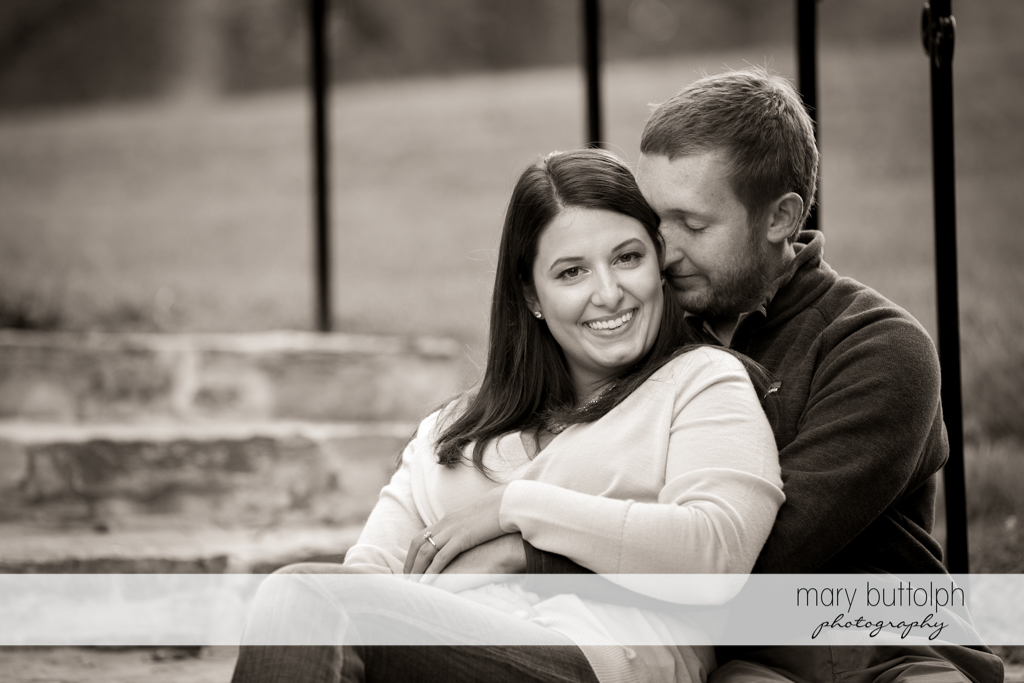 Couple relaxing on a bench in the park at Marcellus Engagement