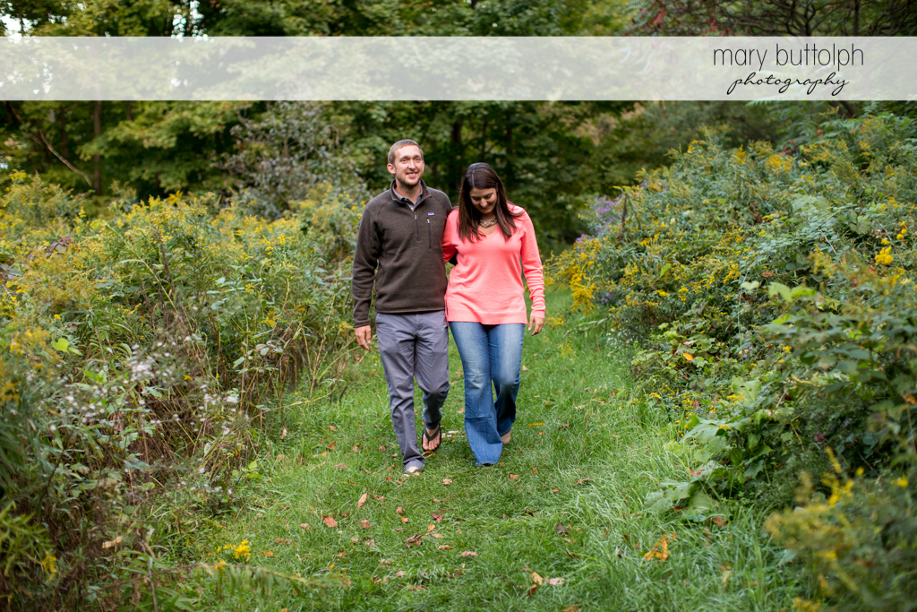 Couple enjoying a quiet stroll in the park at Marcellus Engagement