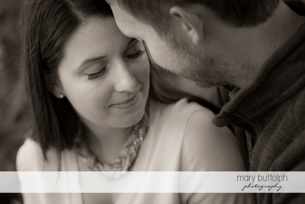 Couple share tender moment at Marcellus Engagement