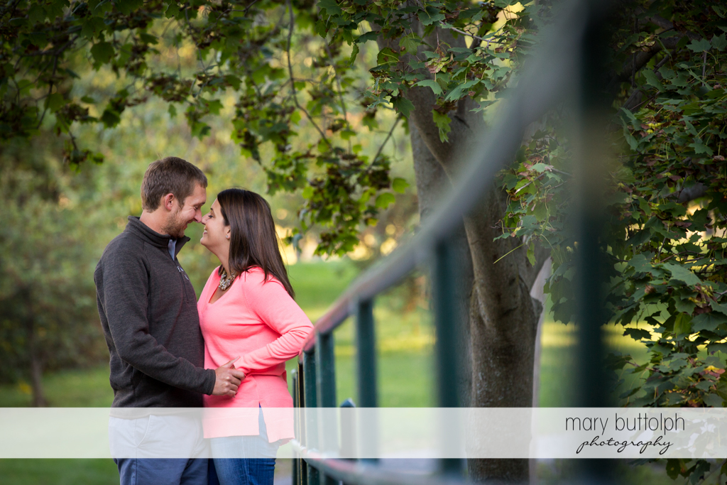 Couple stop by a bridge in the park at Marcellus Engagement