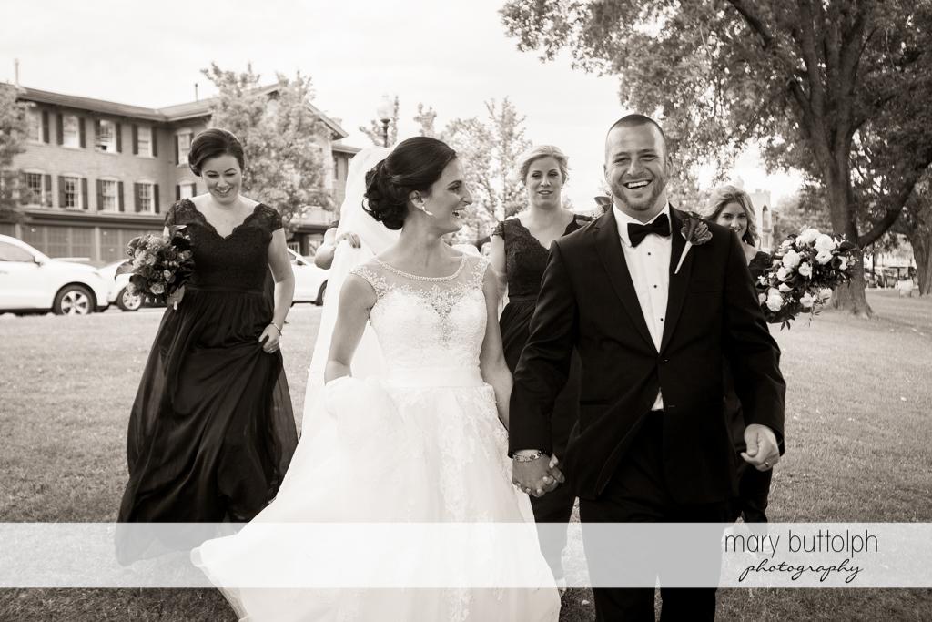Couple and bridesmaids head to church at Anyela's Vineyards Wedding