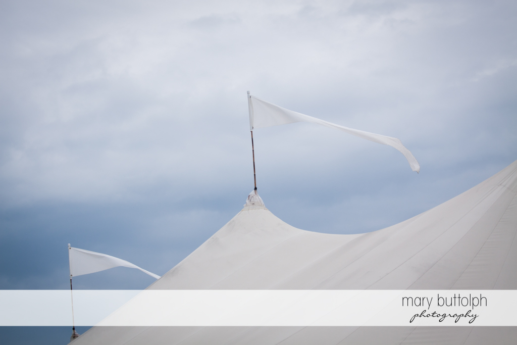 White flags on top of the wedding tent at Anyela's Vineyards Wedding