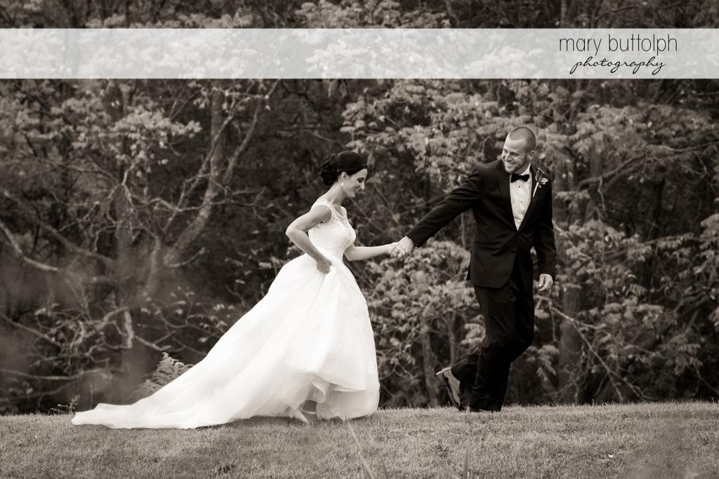 Couple walk in the garden at Anyela's Vineyards Wedding