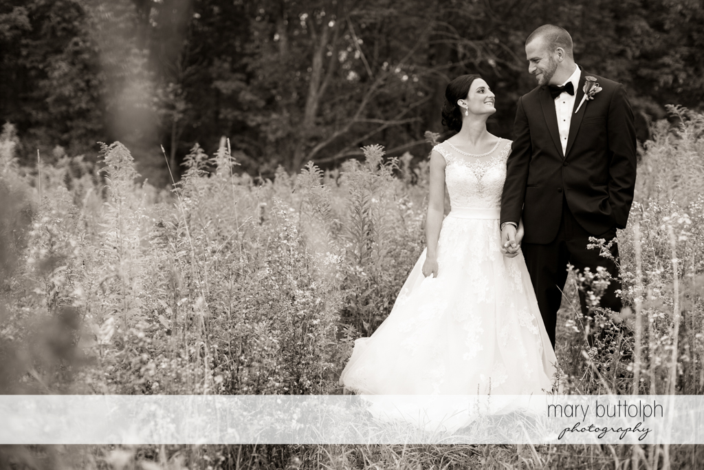 Couple surrounded by plants in the garden at Anyela's Vineyards Wedding