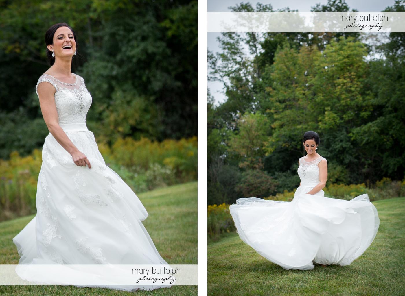 Bride shows her wedding dress in the garden at Anyela's Vineyards Wedding
