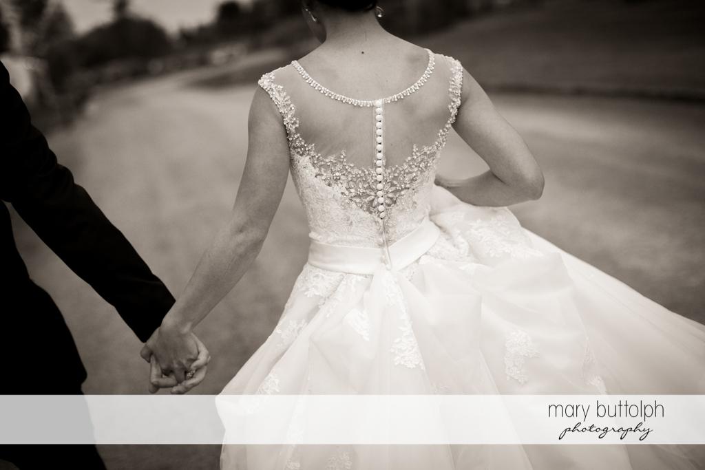 Back view of the bride's wedding dress at Anyela's Vineyards Wedding