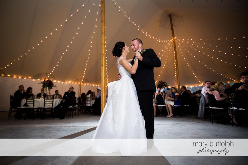 Couple dance in the wedding tent at Anyela's Vineyards Wedding