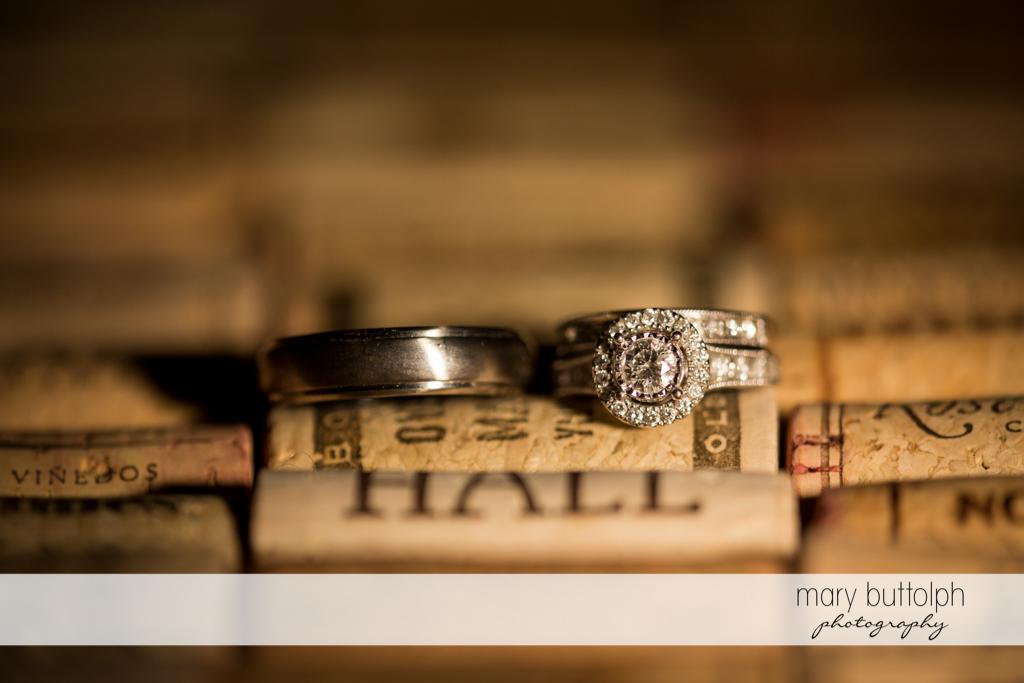 Couple's wedding rings on top of wine corks at Anyela's Vineyards Wedding
