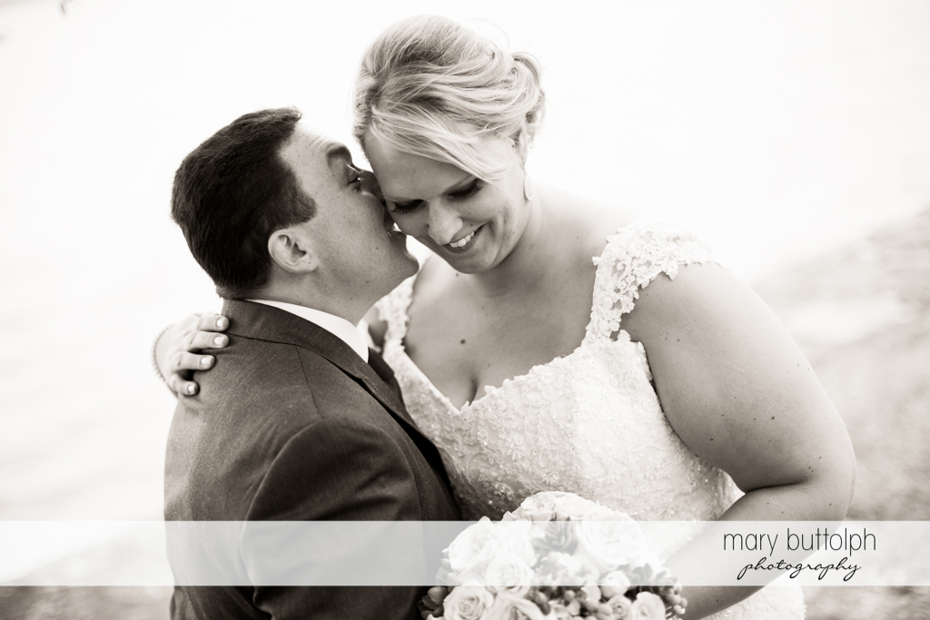 Groom whispers to the bride at the Lodge at Welch Allyn Wedding