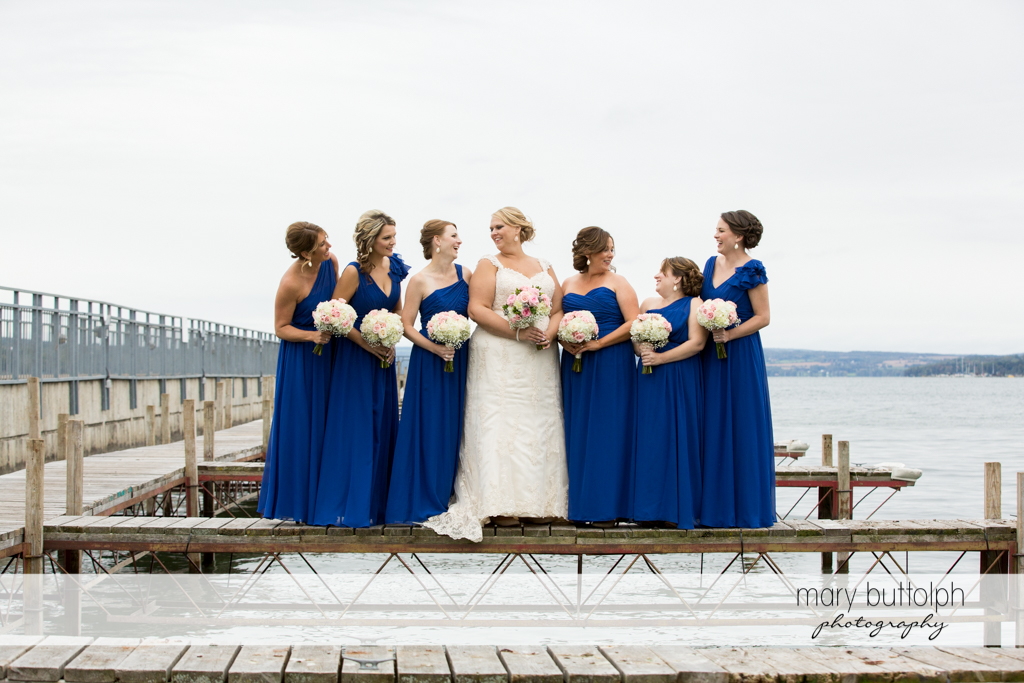 Bride and bridesmaids with bouquets at the docks at the Lodge at Welch Allyn Wedding