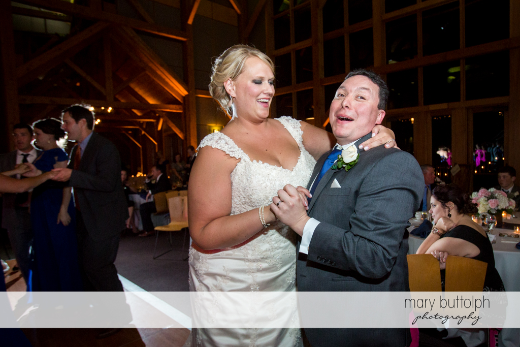 Couple dance with guests at the Lodge at Welch Allyn Wedding