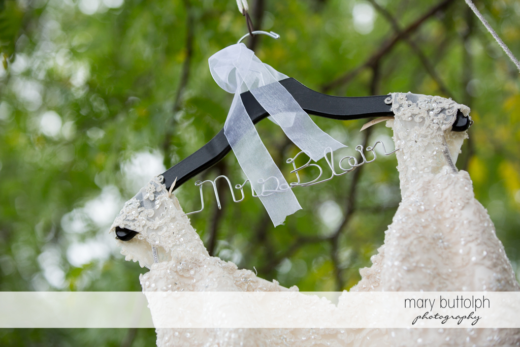 Bride's wedding dress and personalized hanger at the Lodge at Welch Allyn Wedding