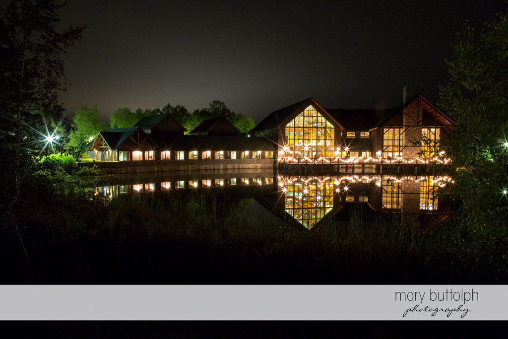 View of the brightly-lit wedding venue near the lake at the Lodge at Welch Allyn Wedding