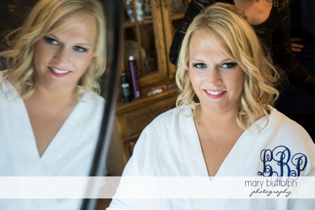Bride and her reflection at the Lodge at Welch Allyn Wedding