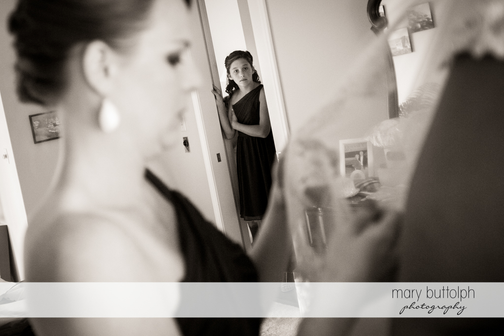 Girl stands at the door to the bride's room at the Lodge at Welch Allyn Wedding