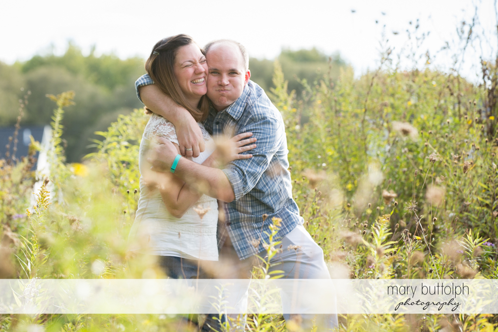 Couple fool around in the park at Skaneateles Engagement