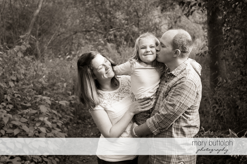 Couple and their daughter in black and white shot at Skaneateles Engagement