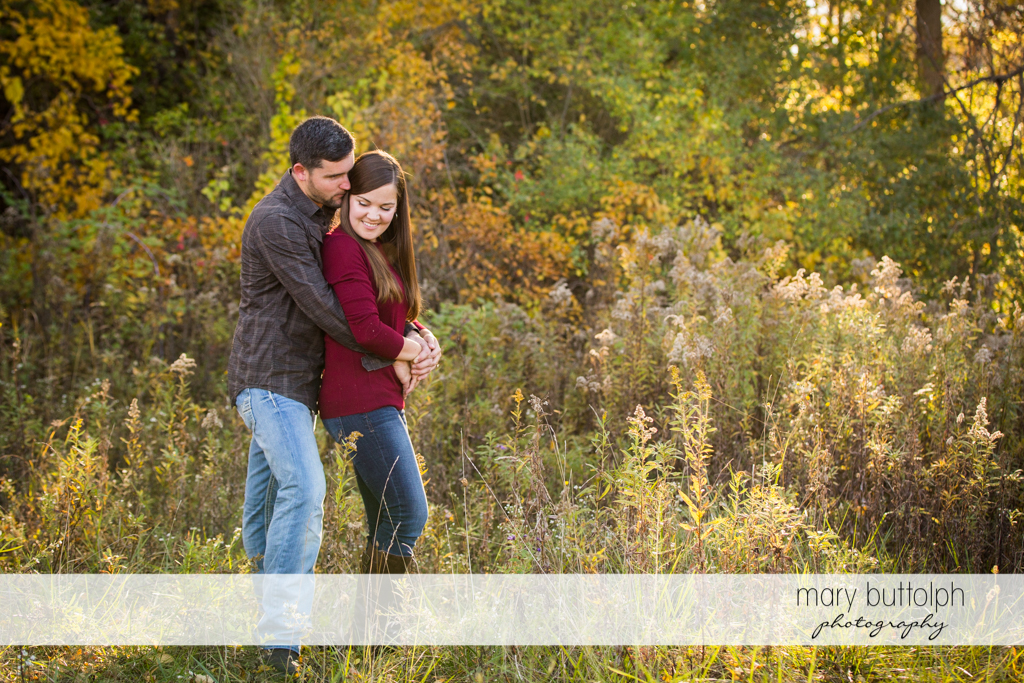 Couple share tender moment with nature at Geneva Engagement
