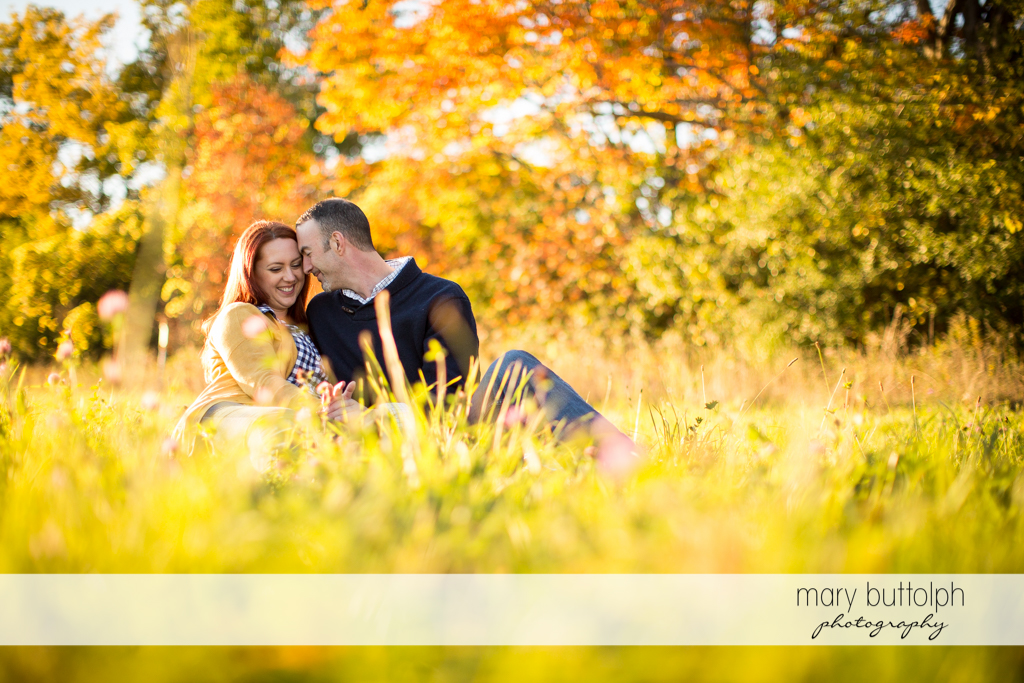 Couple take a break in the park at Cazenovia Engagement