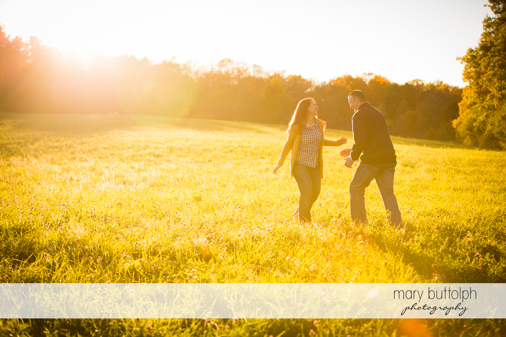 Couple enjoy the sunlight in the park at Cazenovia Engagement