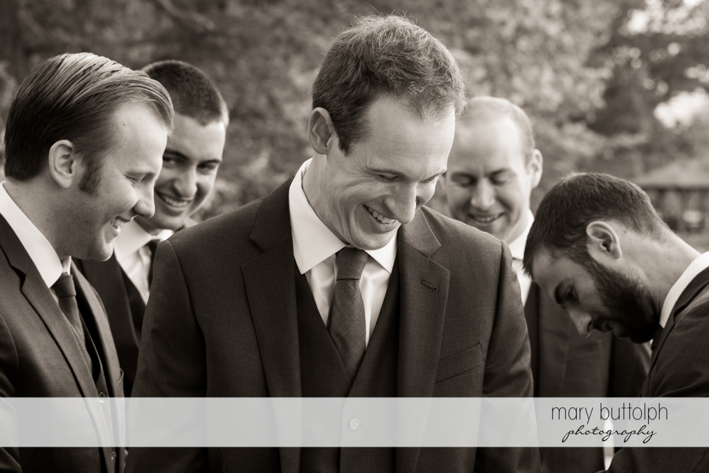 Groom shares a light moment with the groomsmen at Frog Pond Bed & Breakfast Wedding