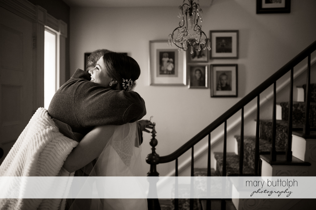 Bride gets a hug from a friend at the Frog Pond Bed & Breakfast Wedding