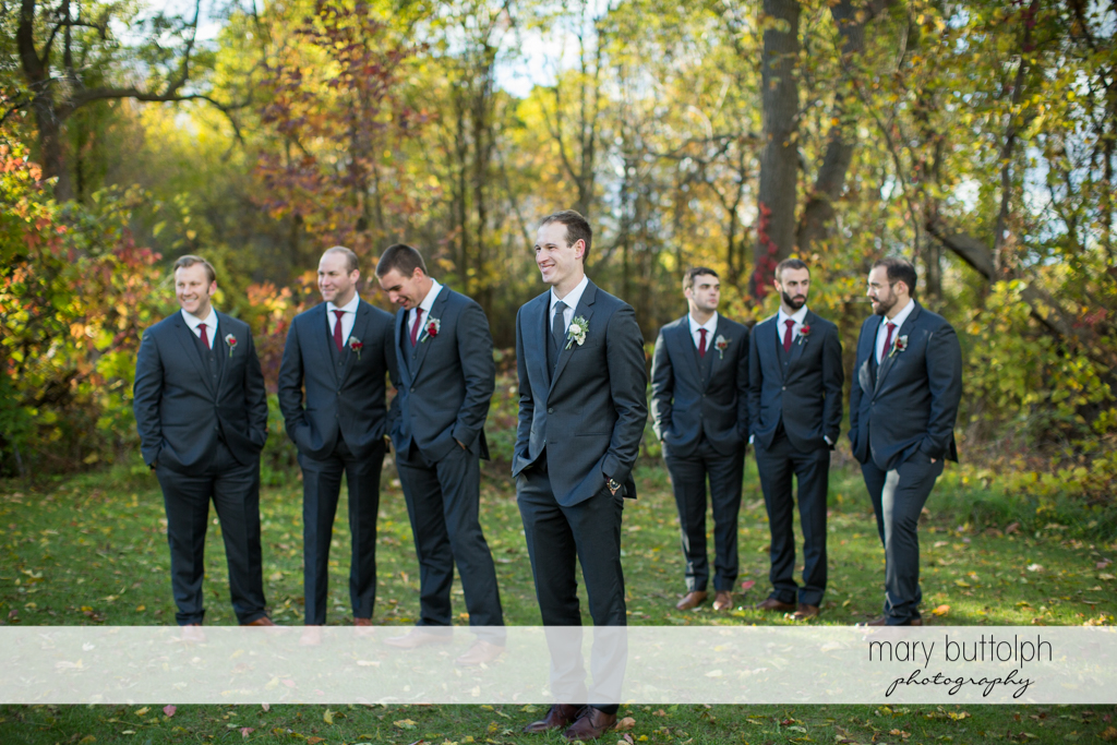 The groom and groomsmen pose in the garden at the Frog Pond Bed & Breakfast Wedding