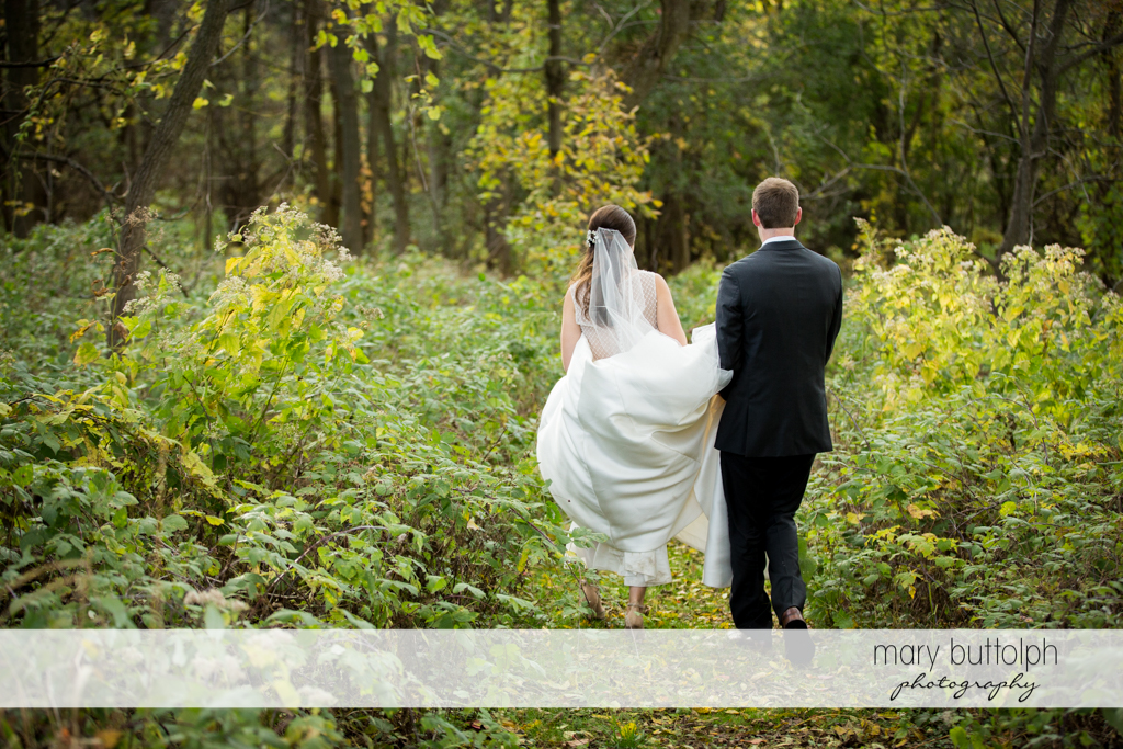 Couple spend time in the woods at the Frog Pond Bed & Breakfast Wedding