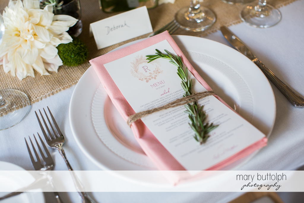 Leaves add a touch of elegance to the silverware and menu at the Frog Pond Bed & Breakfast Wedding
