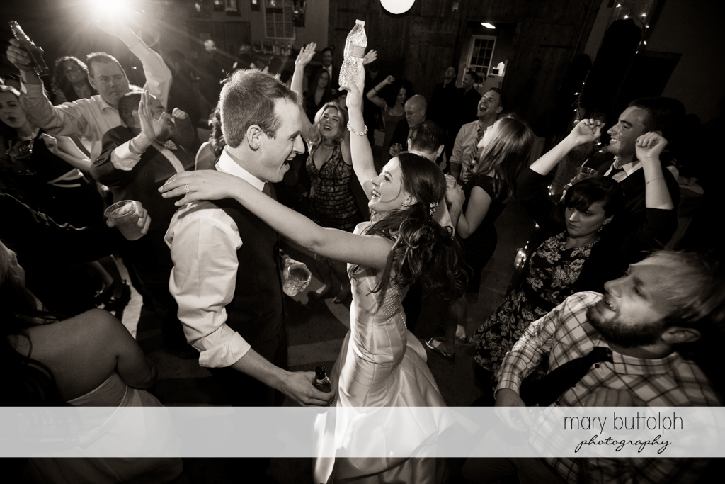 Couple dance the night away with guests at the Frog Pond Bed & Breakfast Wedding