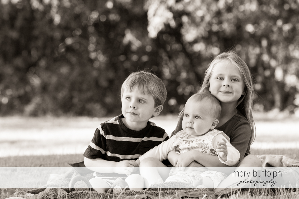Siblings in a group shot in the garden at Skaneateles Lake