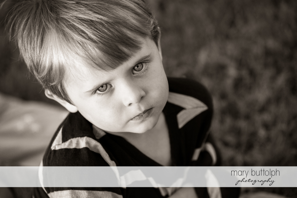 Boy appears to be thinking of something in this black and white shot at Skaneateles Lake