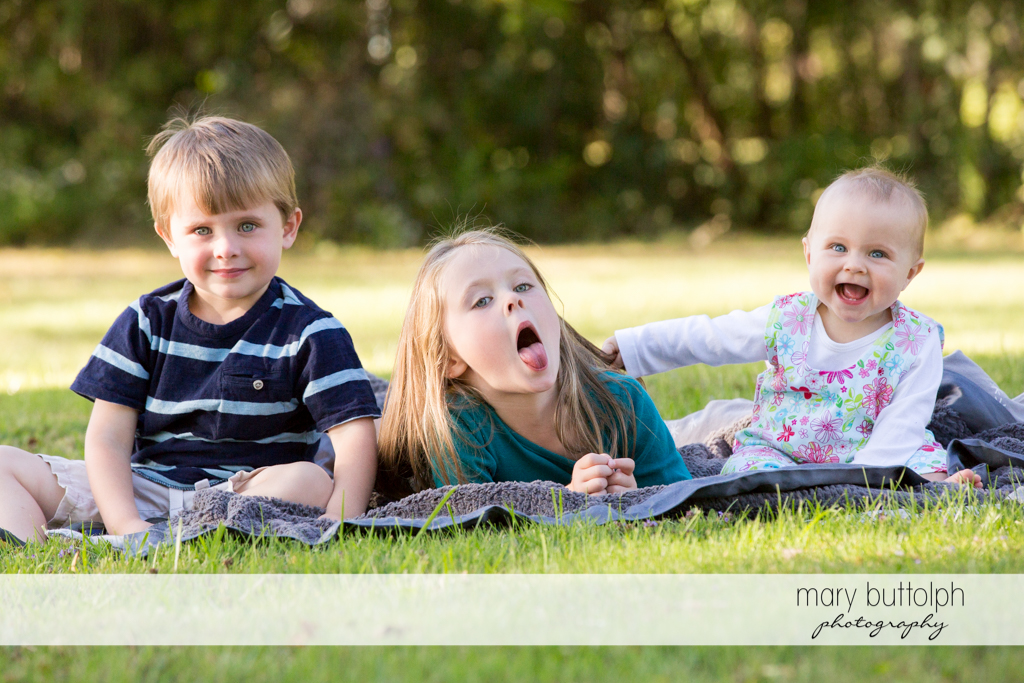 Siblings come up with three different expressions in the garden at Skaneateles Lake