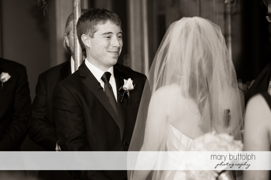 Groom faces the bride at the Lodge at Welch Allyn Wedding