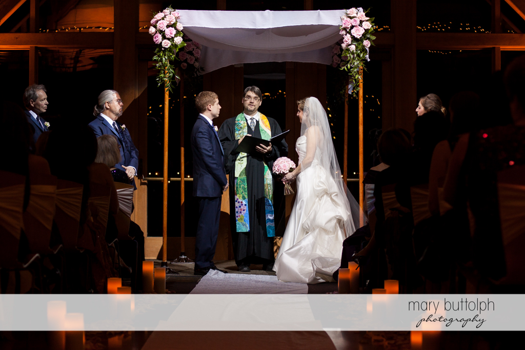 Couple and priest at the wedding ceremony at the Lodge at Welch Allyn Wedding